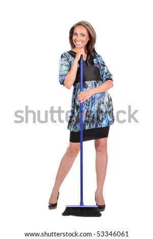 portrait of a beautiful housewife with broom - stock photo