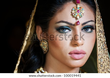 portrait of a beautiful Indian bride - stock photo