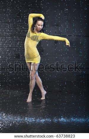 Portrait of a beautiful jazz dancer in aqua studio - stock photo