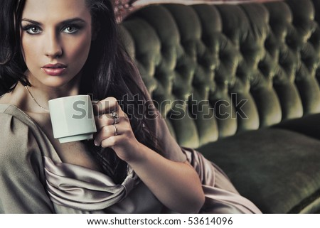 Portrait of a beautiful lady drinking afternoon coffee - stock photo