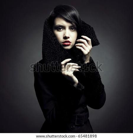 Portrait of a beautiful lady in an elegant coat - stock photo