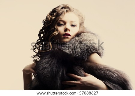 portrait of a beautiful lady in fur - stock photo