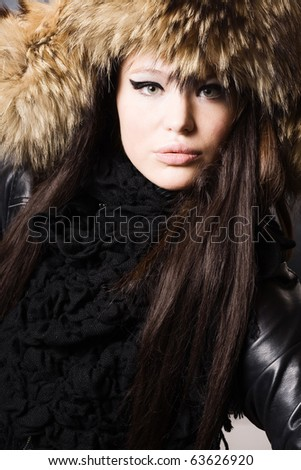 portrait of a beautiful lady in fur cap - stock photo
