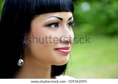 Portrait of a beautiful lady outdoors in summer - stock photo