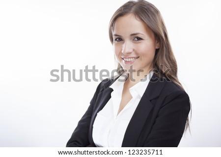 Portrait of a beautiful latin business woman smiling - stock photo