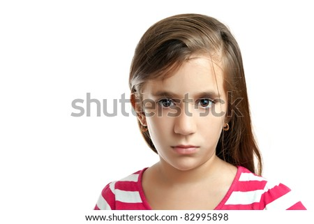 Portrait of a beautiful latin girl with a serious expression isolated on a white background - stock photo
