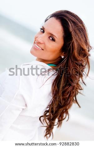 Portrait of a beautiful latin woman at the beach - stock photo