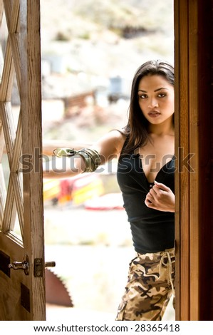 Portrait  of a beautiful latina standing in a doorway