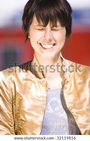 Portrait of a beautiful laughing young female student - stock photo