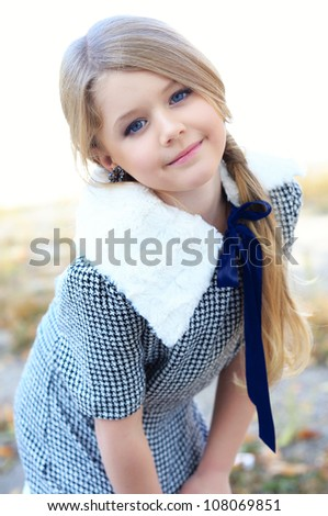 Portrait of a beautiful liitle girl - stock photo