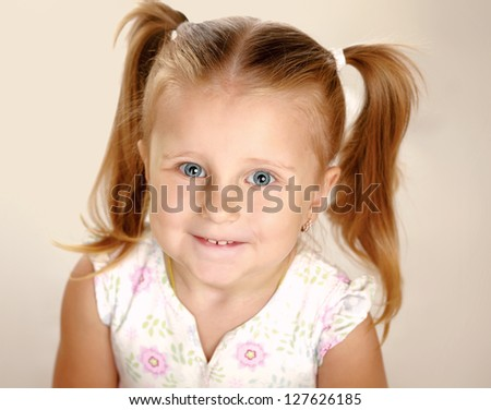 Portrait of a beautiful liitle girl close-up - stock photo