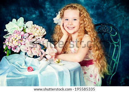 Portrait of a beautiful little angelic girl smiling at camera. Vintage background. - stock photo