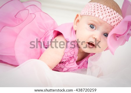 Portrait of a beautiful little baby girl in pink