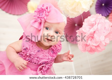 Portrait of a beautiful little baby girl in pink - stock photo