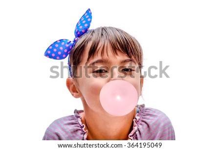 Portrait of a beautiful little girl blowing bubbles on the white background - stock photo