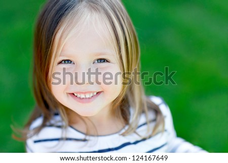 Portrait of a beautiful little girl close-up. - stock photo