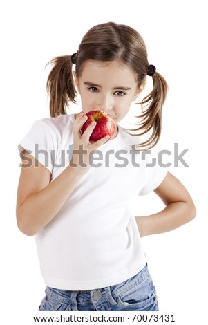 Portrait of a beautiful little girl eating a red apple
