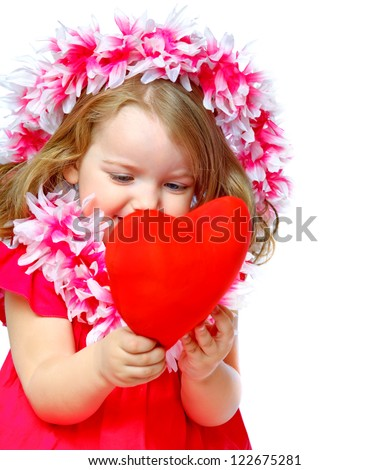 portrait of a beautiful little girl holding a heart