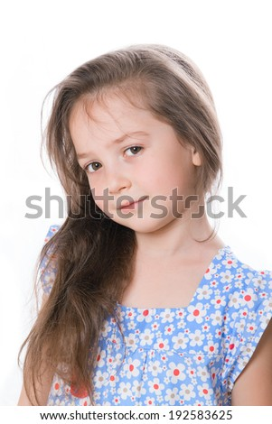 Portrait of a beautiful little girl in a blue blouse, white background