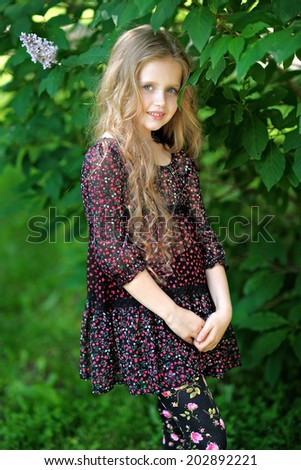 portrait of a beautiful little girl in summer - stock photo