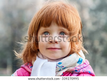 Portrait of a beautiful little girl in the park - stock photo