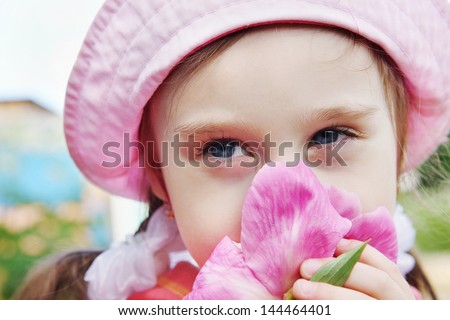 Portrait of a Beautiful Little Girl with Peony Flower - stock photo
