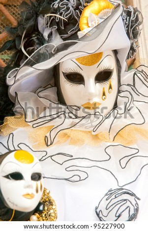 Portrait of a Beautiful mask in Venice, Italy. - stock photo