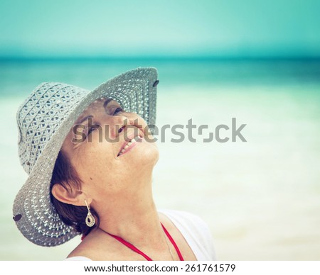 portrait of a beautiful middle-aged woman on the background of the sea - stock photo