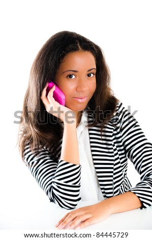 Portrait of a beautiful mixed race teen girl, on a mobile telephone with long dark hair  - isolated on white - stock photo