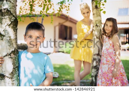 Portrait of a beautiful mother and her kids - stock photo