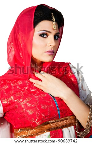 portrait of a beautiful muslim bride in red dress - stock photo