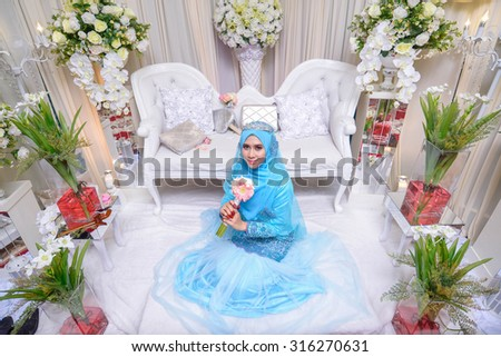 Portrait of a beautiful muslim bride with Beautiful decoration wedding ceremony