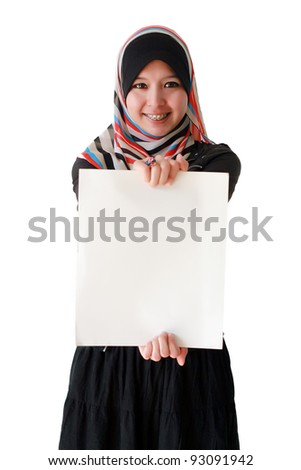 Portrait of a beautiful Muslim woman holding a white paper, isolated on white background - stock photo