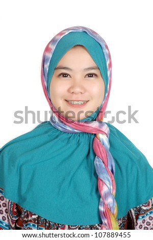 portrait of a beautiful muslim woman wearing a headscarf isolated on white background - stock photo