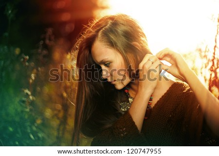 portrait of a beautiful, mysterious girl in forest, mother preroda, fashion spring autumn - stock photo