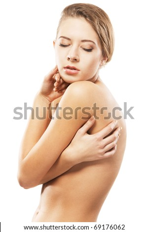 Portrait of a beautiful naked young woman, gray background - stock photo