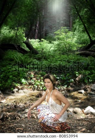 Portrait of a beautiful natural woman in forest outdoors