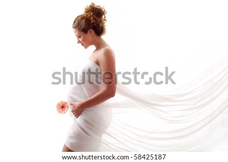 Portrait of a beautiful pregnant woman in white chiffon shawl - stock photo