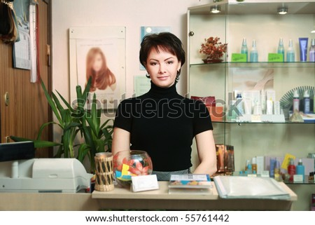 portrait of a beautiful receptionist in spa salon