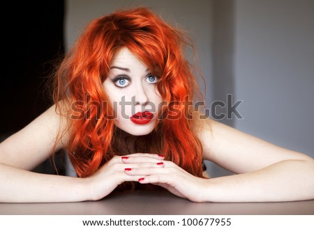 Portrait of a beautiful red haired girl.