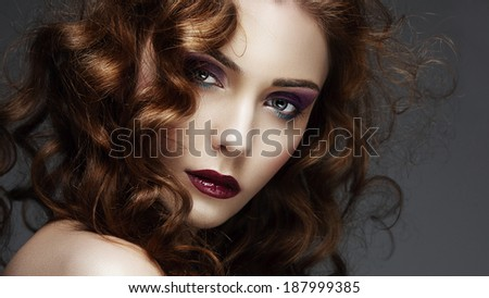 Portrait of a beautiful redhead and curly girl with bright makeup, close up - stock photo