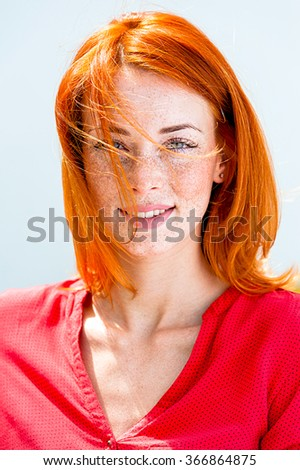 Portrait of a beautiful redhead freckled woman - stock photo