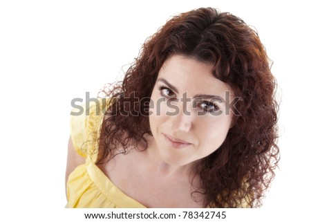 Portrait of a beautiful redhead woman looking up. Studio shot, over white background. - stock photo