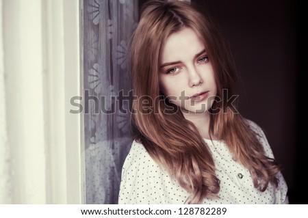 portrait of a beautiful sad girl - stock photo