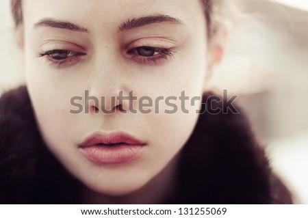 portrait of a beautiful sad girl closeup - stock photo