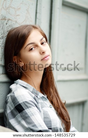 portrait of a beautiful sad girl closeup outdoor - stock photo