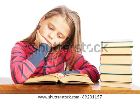 Portrait of a beautiful schoolgirl reading a book on white background - stock photo