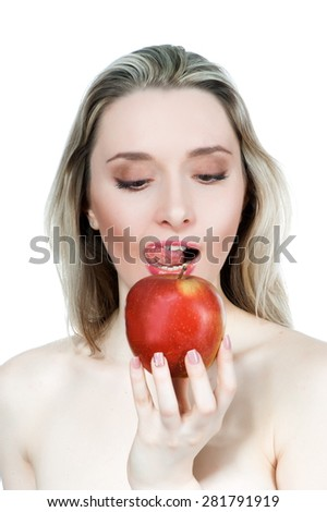 Portrait of a beautiful sexy blonde girl with red apple on a white background isolated - stock photo