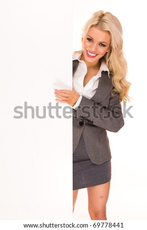 Portrait of a beautiful sexy blonde happy business woman holding a blank billboard. Ready to add text.