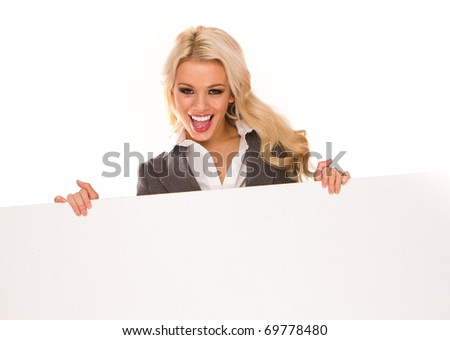 Portrait of a beautiful sexy blonde happy business woman holding a blank billboard. Ready to add text. - stock photo
